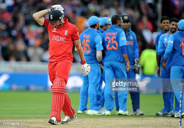 England's Tim Bresnan reacts after being run out during the 2013 ICC Champions Trophy Final cricket match between England and India at Edgbaston in...