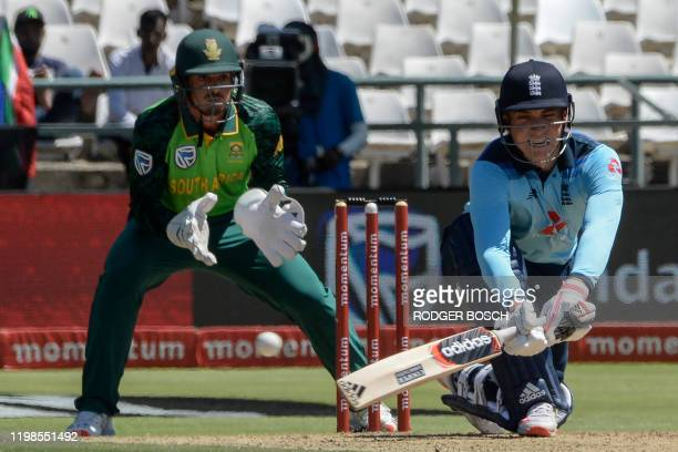 England's Tom Banton is watched by South Africa's Quinton de Kock as he plays a reverse sweep shot during the first one day international cricket...