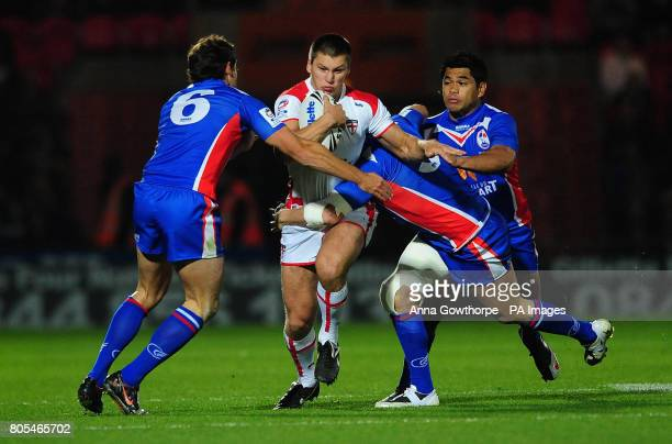 England's Tom Briscoe is tackled by France's Thomas Bosc Sebastien Raguin and Dimitri Pelo during the Gillette Four Nations match at the Keepmoat...
