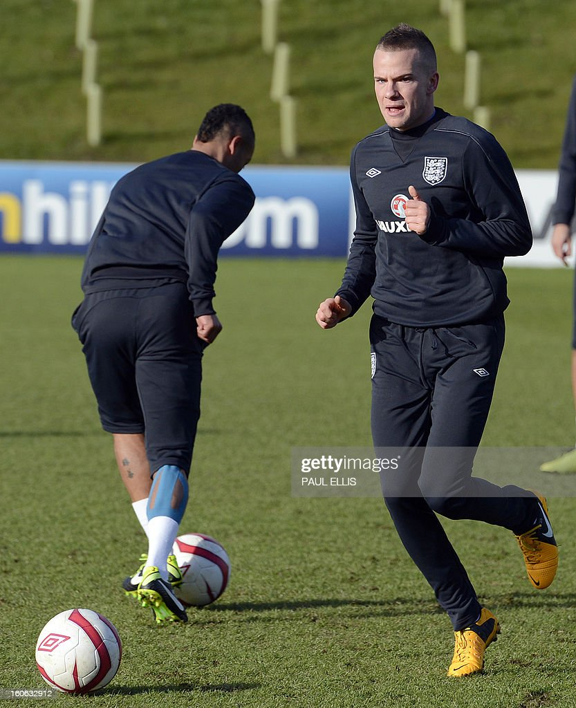 England's Tom Cleverley (R) takes part in a team training session at St George's Park in central England, on February 4, 2013. England take on Brazil at London's Wembley stadium in an international friendly on February 6. AFP PHOTO/Paul Ellis/NOT