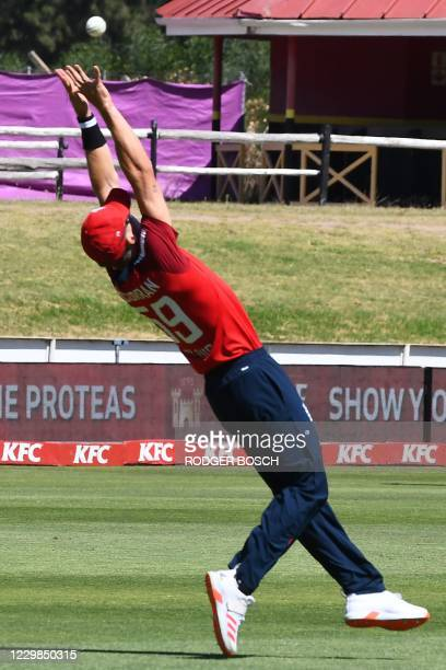 England's Tom Curran catches the ball dismissing South Africa's captain Quinton de Kock during the second T20 international cricket match between...