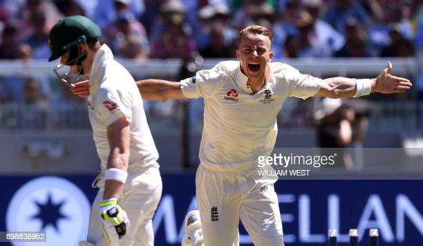 TOPSHOT England's Tom Curran celebrates bowling Australia's batsman Steve Smith on the second day of the fourth Ashes cricket Test match at the MCG...