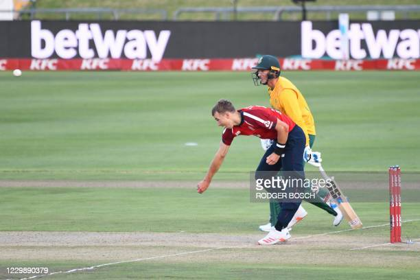 England's Tom Curran delivers a ball as South Africa's Rassie van der Dussen looks on during the third T20 international cricket match between South...