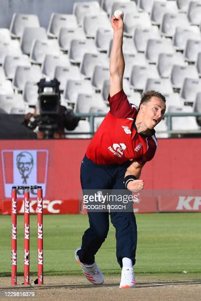 England's Tom Curran delivers a ball during the first T20 international cricket match between South Africa and England at Newlands stadium in Cape...