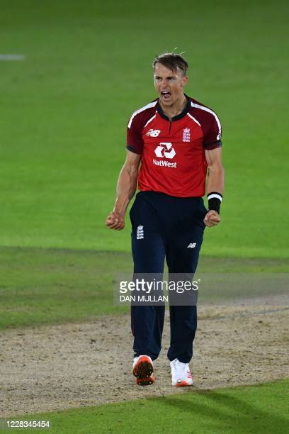 England's Tom Curran reacts after bowling the final over to win the match during the international Twenty20 cricket match between England and...