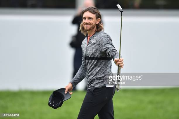 England's Tommy Fleetwood acknowledges the gallery on the 18th green after his second round 66 on day two of the golf PGA Championship at Wentworth...