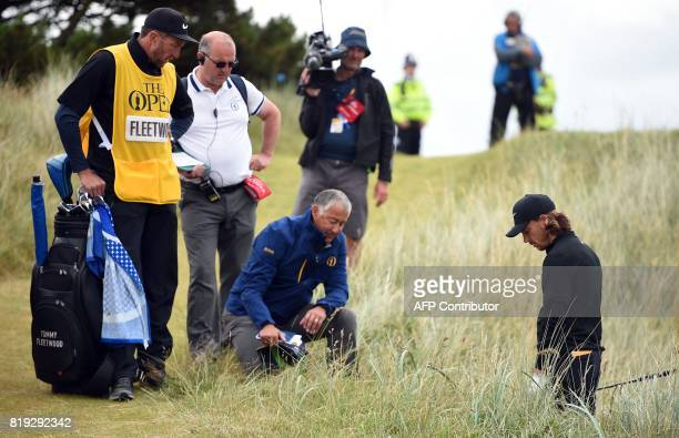 TOPSHOT England's Tommy Fleetwood takes advice from a rules official as he finds himself in trouble on the 6th hole during his opening round on the...