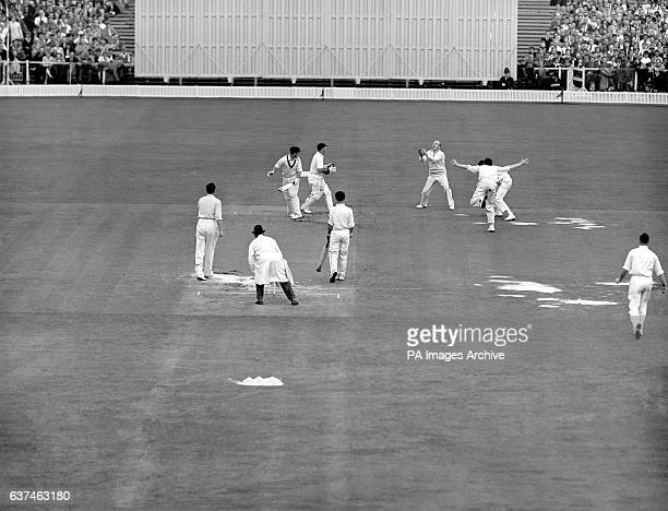 England's Tony Lock takes a catch to dismiss Australia's Jim Burke for 33 off the bowling of Jim Laker