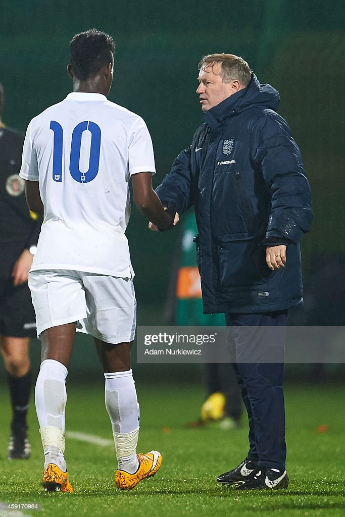 England's trainer coach Neil Dewsnip (R) thanks for the game toEngland's Josh Onomah (L) during the international friendly match Under-18 between Poland and England on November 17, 2014 on the MOSiR Stadium in Gdansk, Poland.