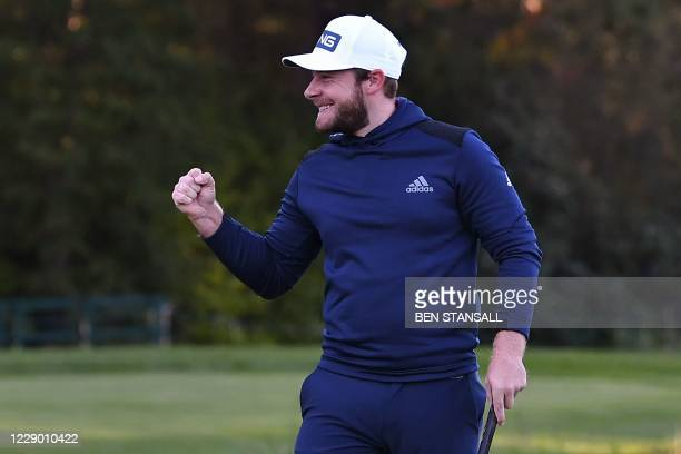 England's Tyrrell Hatton celebrates after playing his winning putt shot on the 18th green on the last day of the PGA Championship at Wentworth Golf...