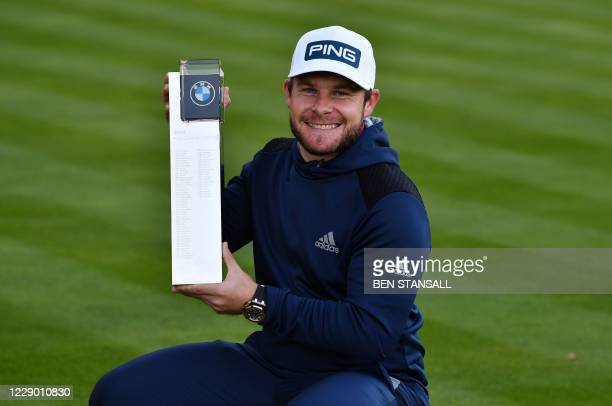 England's Tyrrell Hatton holds up the winner's trophy during the awards presentation on the last day of the PGA Championship at Wentworth Golf Club...