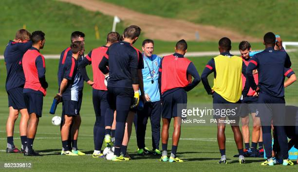England's U21 coach Steve Holland speaks to the players during a training session at St George's Park Burton