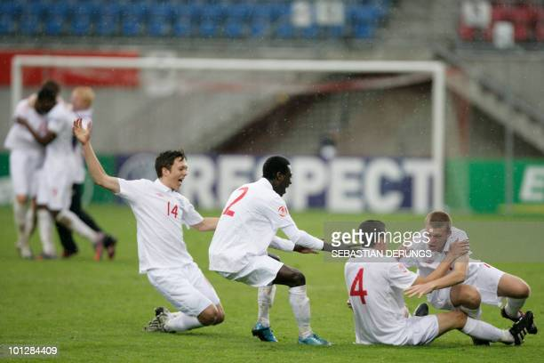 England's under 17 football team react after they defeat Spain during their UEFA Euro 2010 Under 17 Football championship Final in Vaduz on May 30...