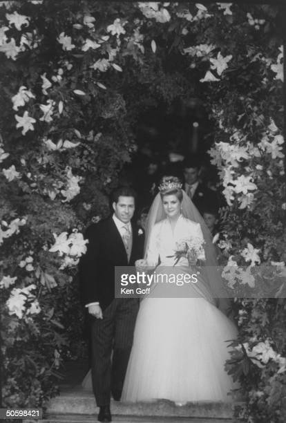 England's Viscount Linley and bride Serena Stanhope walking through a flowered arch after taking their wedding vows at St Margaret's Church...