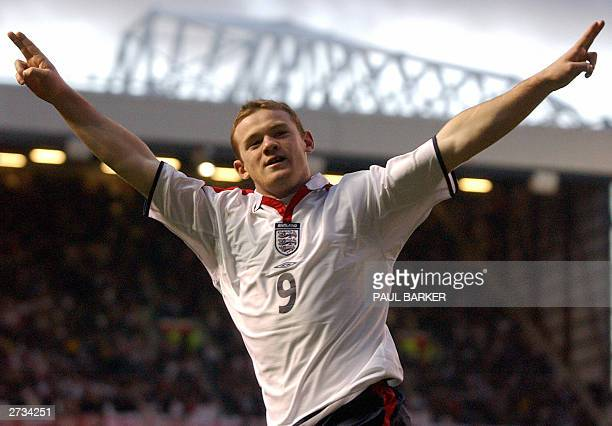 England's Wayne Rooney celebrates scoring against Denmark during their international friendly match 16 November 2003 at Old Trafford in Manchester...