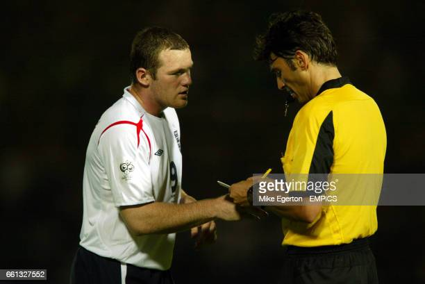 England's Wayne Rooney is booked by referee Massimo Busacca against Northern Ireland.