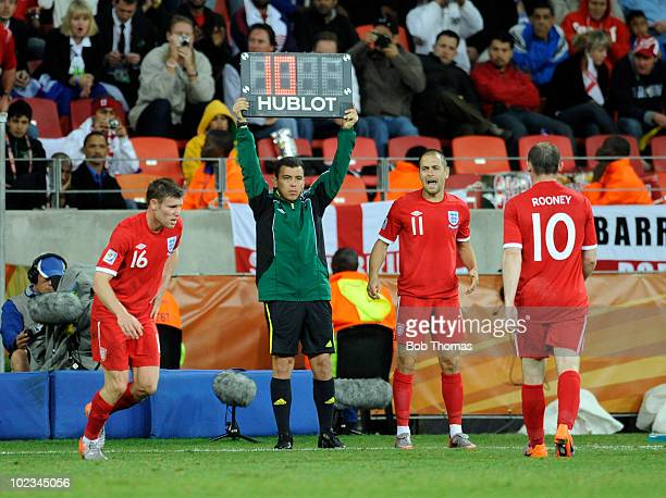 England's Wayne Rooney is subsituted for Joe Cole during the 2010 FIFA World Cup South Africa Group C match between Slovenia and England at the...