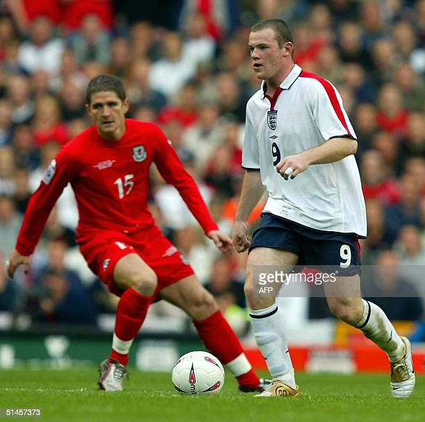 England's Wayne Rooney keeps the ball away from Wales' Carl Robinson during their World Cup Qualifing match at Old Trafford in Manchester England 09...