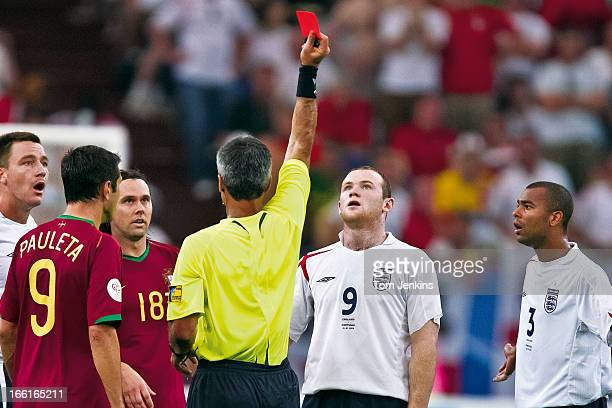 England's Wayne Rooney looks up at the red card as he is sent off by referee Horacio Elizondo during the England v Portugal FIFA World Cup...