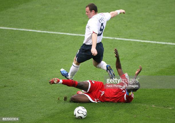 England's Wayne Rooney skips the challenge of Trinidad and Tobago's Dwight Yorke