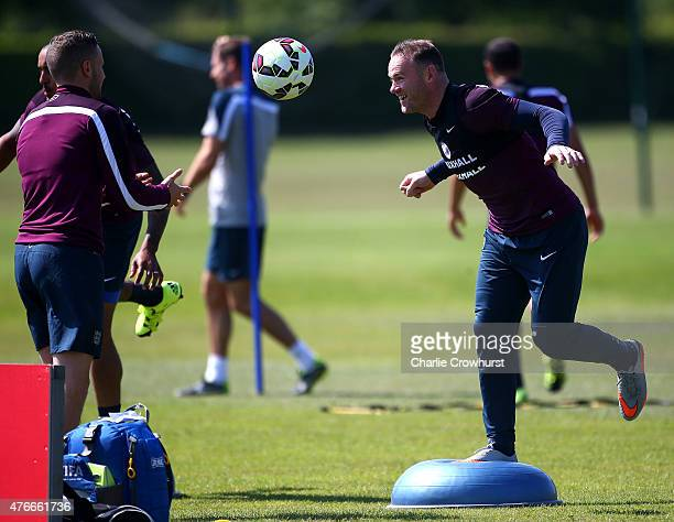 England's Wayne Rooney trains using a balance ball during the England Training Session ahead of their EURO 2016 Group E qualifier against Slovenia on...