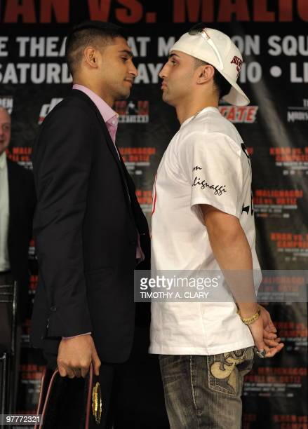 England's WBA Super Lightweight World Champion Amir Khan and former world title holder Paulie The Magic Malignaggi from New York pose after a press...
