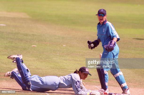 England's wicket keeper Jane Cassar screams in delight as India's Chopra Anjum is run out