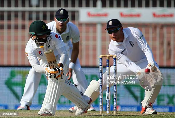 England's wicket keeper Jonny Baistow tries to catch the ball played by Pakistan's Mohammad Hafeez during the third day of the third Test cricket...