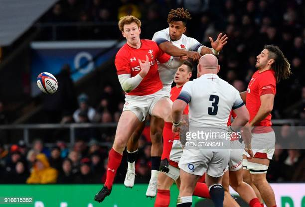 England's wing Anthony Watson and Wales' flyhalf Rhys Patchell jump for the ball during the Six Nations international rugby union match between...