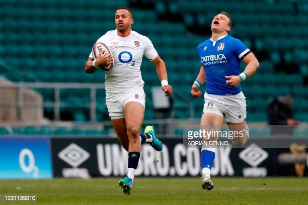 England's wing Anthony Watson runs to score his team's fourth try, his second, during the Six Nations international rugby union match between England...