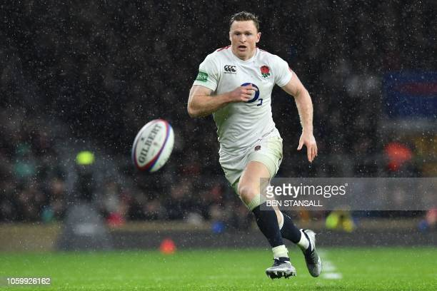 England's wing Chris Ashton chases the ball during the autumn international rugby union match between England and New Zealand at Twickenham stadium...