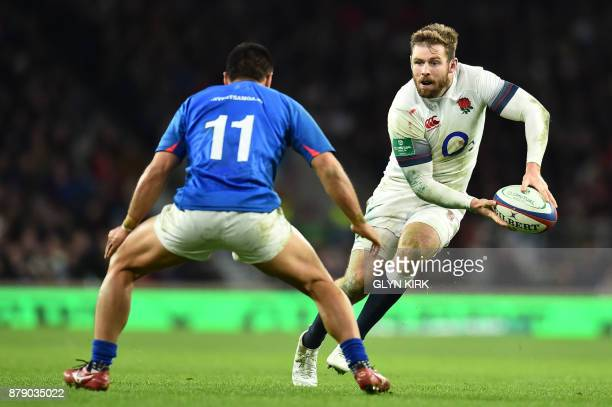 TOPSHOT England's wing Elliot Daly holds the ball past Samoa's wing David Lemai during the autumn international rugby union test match between...