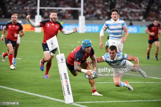 England's wing Jack Nowell scores a try during the Japan 2019 Rugby World Cup Pool C match between England and Argentina at the Tokyo Stadium in...
