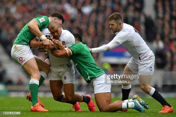 England's wing Jonathan Joseph is tackled during the Six Nations international rugby union match between England and Ireland at the Twickenham, west...