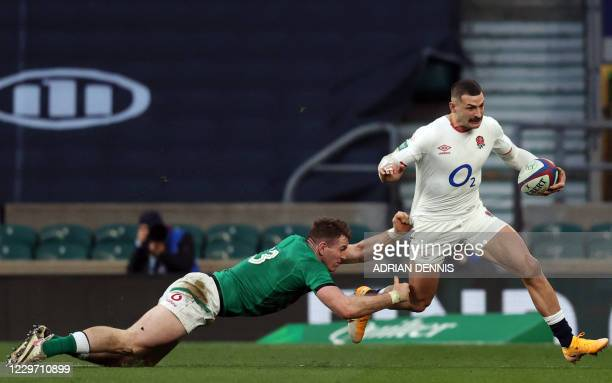 England's wing Jonny May avoids the tackle of Ireland's centre Chris Farrell during the Autumn Nations Cup international rugby union match between...