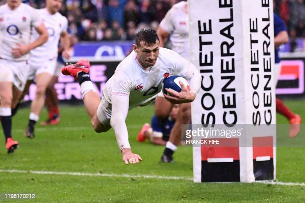 England's wing Jonny May dives across the line to score a try during the Six Nations rugby union tournament match between France and England at the...