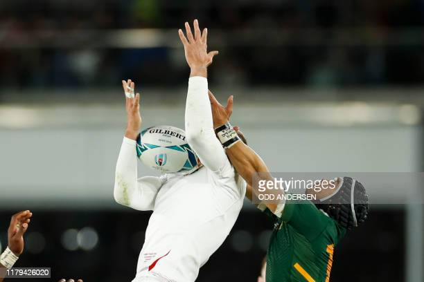 England's wing Jonny May fights for the ball with South Africa's wing Cheslin Kolbe during the Japan 2019 Rugby World Cup final match between England...