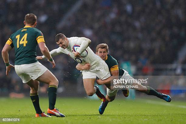 TOPSHOT England's wing Jonny May is tackled by South Africa's flyhalf Pat Lambie during the rugby union test match between England and South Africa...