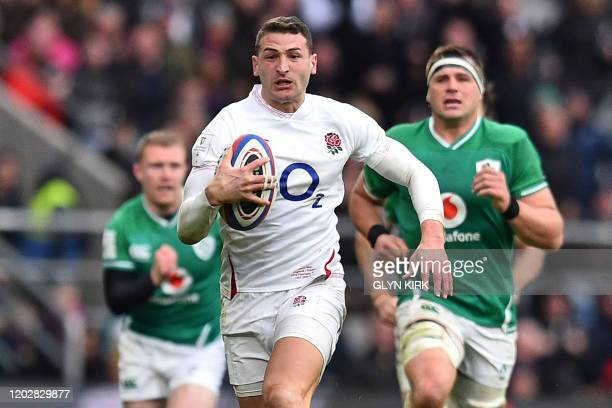 England's wing Jonny May makes a break during the Six Nations international rugby union match between England and Ireland at the Twickenham, west...