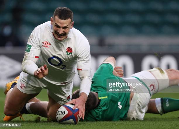 England's wing Jonny May scores the second try during the Autumn Nations Cup international rugby union match between England and Ireland at...