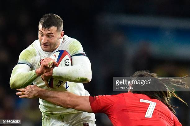 England's wing Jonny May tries to avoid a tackle from Wales' flanker Josh Navidi during the Six Nations international rugby union match between...