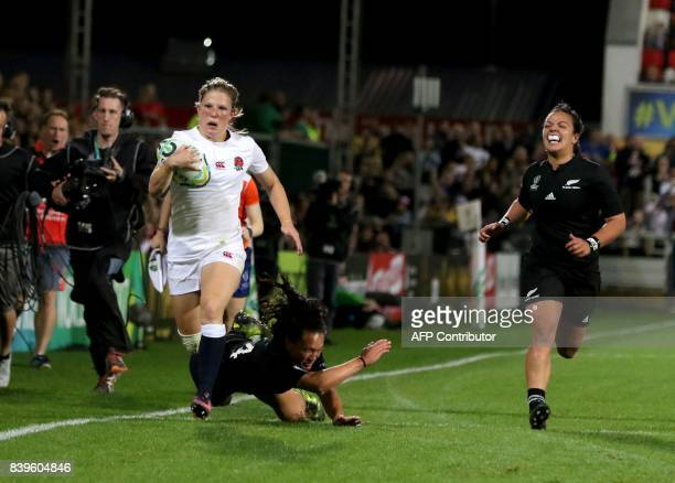 England's wing Lydia Thompson runs in a try during the Women's Rugby World Cup 2017 final match between England and New Zealand at The Kingspan...