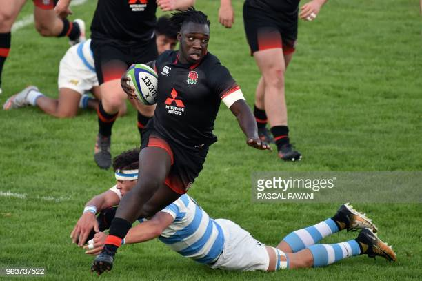 England's winger Gabriel Ibitoye vies with Argentina's n°8 Juan Bautista Pedemonte during the U20 World Rugby Championship match between England and...