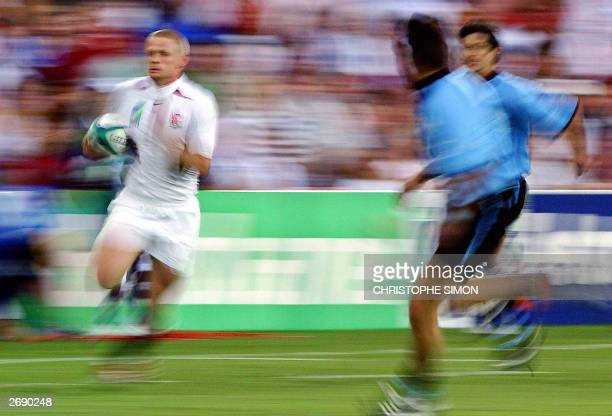 England's winger Iain Balshaw runs past Uruguay's defense on his way to scoring a try during the Rugby World Cup Pool C game between England and...