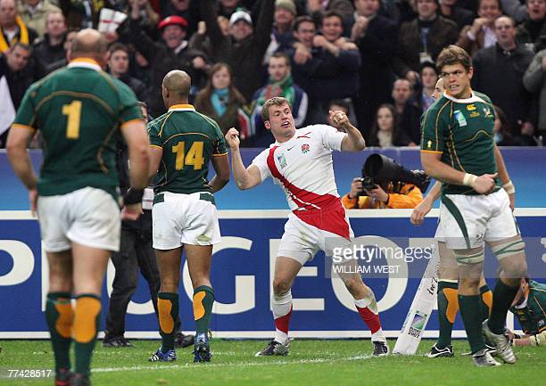 England's winger Mark Cueto gestures after missing a try because of the tackle of South Africa's number 8 Danie Rossouw during the rugby union World...