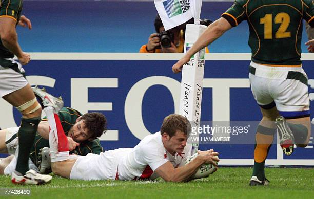 England's winger Mark Cueto misses a try because of the tackle of South Africa's number 8 Danie Rossouw during the rugby union World Cup final match...