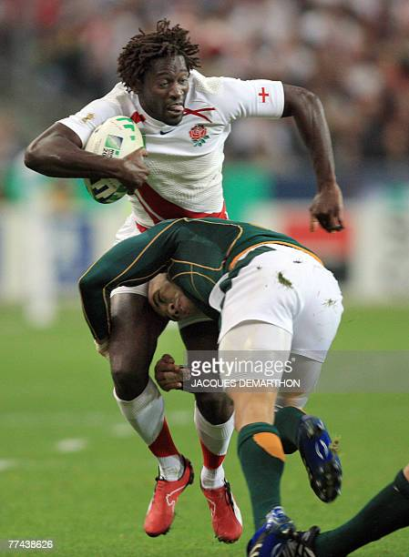 England's winger Paul Sackey is tackled by South Africa's winger Bryan Habana during the rugby union World Cup final match England vs. South Africa,...