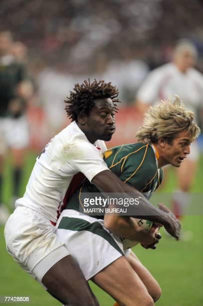 England's winger Paul Sackey tackles South Africa's fullback Percy Montgomery during the rugby union World Cup final match England vs. South Africa,...