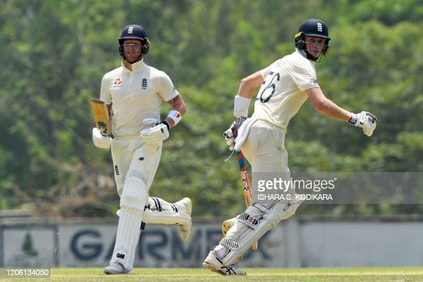 England's Zak Crawley and Ben Stokes run between the wickets during the third day of a threeday practice match between Sri Lanka Cricket XI and...