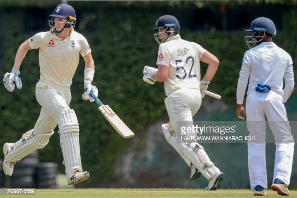 England's Zak Crawley and Dom Sibley run between the wickets during the opening day of a fourday practice match between Sri Lanka Board President's...
